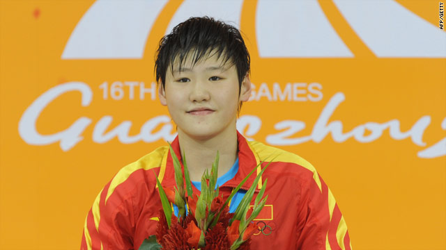 Ye Shi Wen proudly displays the gold medal she won in the women's 400m medley.