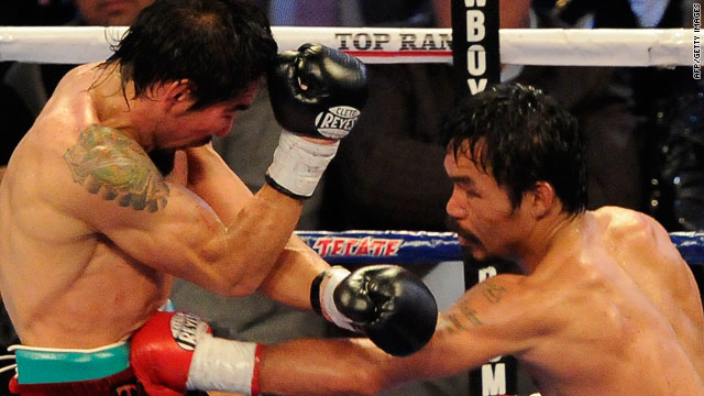 Manny Pacquiao (right) unleashes yet another flurry of punches against Antonio Margarito in Dallas.