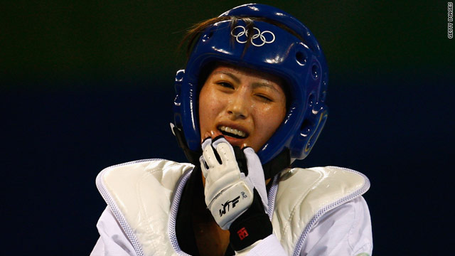 Yang Shu-Chun, pictured at the Beijing Olympics in 2008, was disqualified for wearing socks deemed to be illegal.