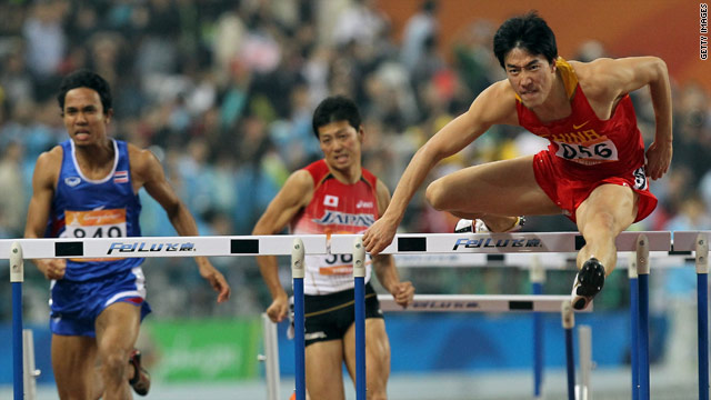Liu Xiang on the way to winning the 110m hurdles, helping China set a new Asian Games record for total medals.
