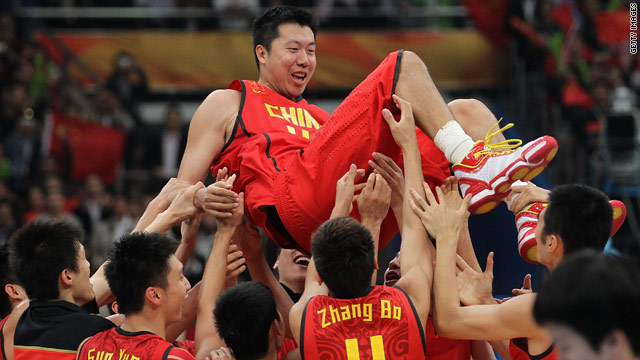 China captain Wang Zhizhi is lifted by his teammates after winning the basketball final in Guangzhou on Friday.