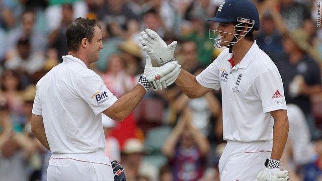 Alastair Cook, right, congratulates Andrew Strauss after the England captain reaches three figures at the Gabba on Saturday.