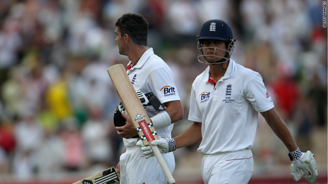 Alastair Cook acknowledges the crowd as he walks off with Kevin Pietersen at the end of the second day in Adelaide.