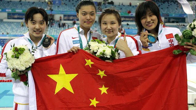 China's women celebrate smashing the world record to claim gold in the 4x200m freestyle relay.