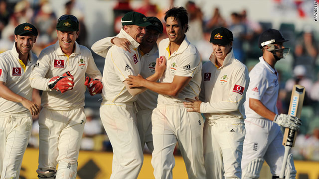 The jubilant Australians celebrate Mitchell Johnson's key dismissal of Jonathan Trott at the WACA.