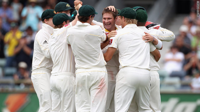 Ryan Harris (center) is swamped by his teammates after removing England batsman Matt Prior in Perth.
