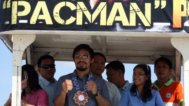 Manny Pacquiao greets the crowds in his native Philippines.