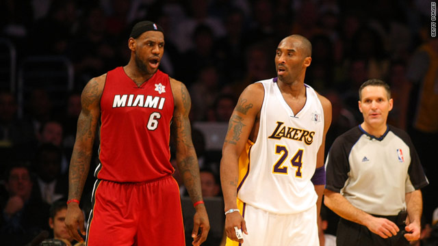 LeBron James (left) and Kobe Bryant exchange words towards the end of the Heat's win in Los Angeles.