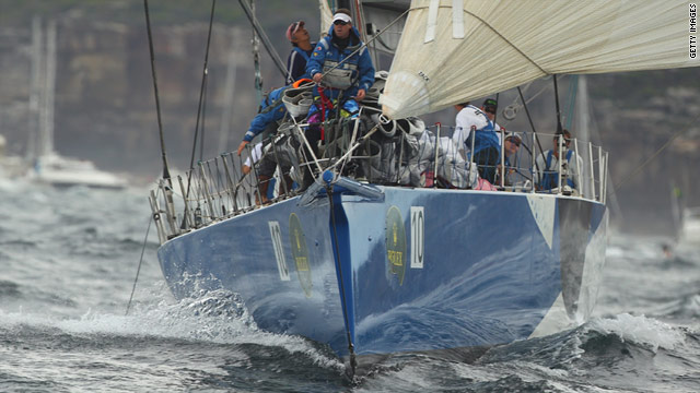 Wild Thing bears down on the spectator boats in a fast start to the Sydney-Hobart yacht race.