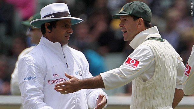 Ricky Ponting, right, argues with Pakistani umpire Aleem Dar after England batsman Kevin Pietersen is given not out.