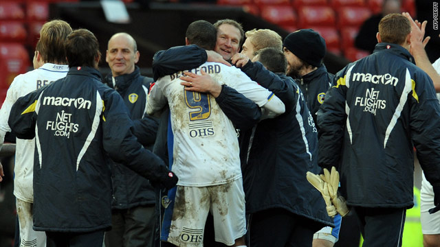 Leeds goalscorer Jermaine Beckford celebrates with manager Simon Grayson after their shock 1-0 FA Cup win over Manchester United.
