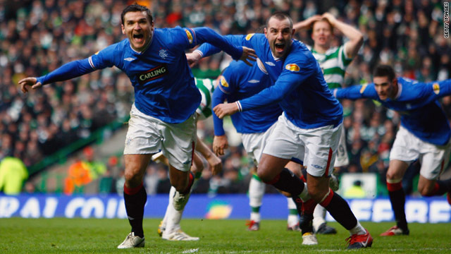 Lee McCulloch wheels away in delight after scoring his invaluable equalizer at Parkhead.