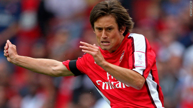 Tomas Rosicky has signed a new Arsenal contract after battling back to form and fitness this season.