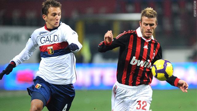 David Beckham battles with Genoa's Domenico Criscito during AC Milan's 5-2 victory at the San Siro.