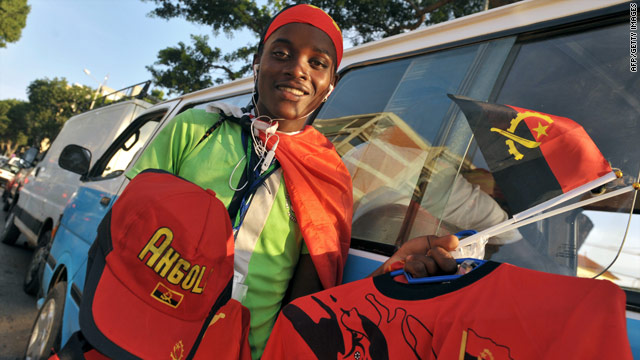 A steet vendor sells merchandise. Preparations for the tournament have been overshadowed by the attack on Togo's team.