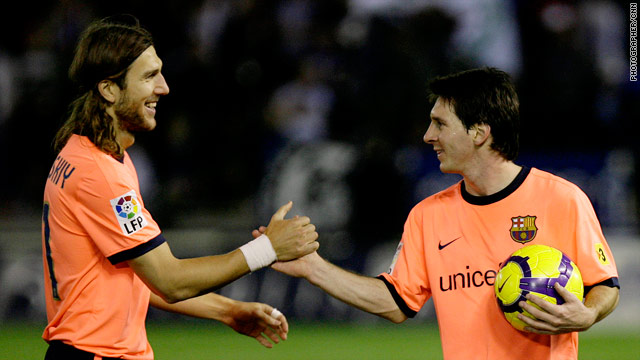 Messi (right) receives the congratulations of Dmytro Chygrynskiy after his hat-trick.
