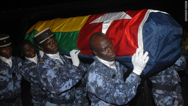 Togolese gendarmes carry the coffin of one of the shooting victims.