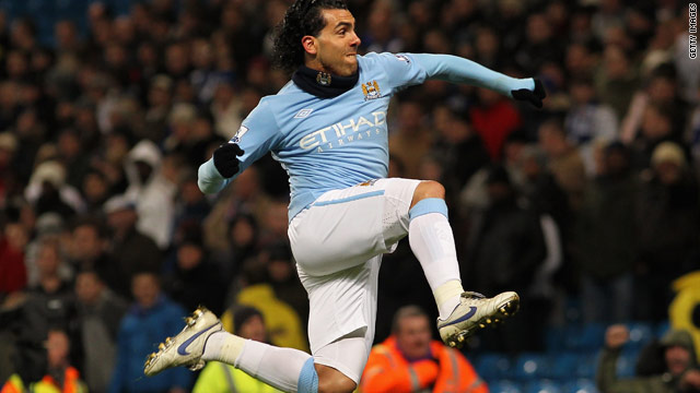 Carlos Tevez celebrates scoring his first Manchester City hat-trick as Roberto Mancini's side moved up to fourth place in the Premier League table.