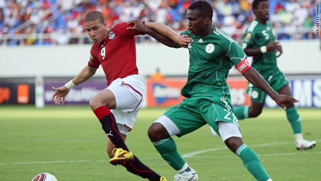 Egypt's Mohamed Zidan, left, shields the ball from Nigeria's Yobo Michae during Tuesday's Group C opener.