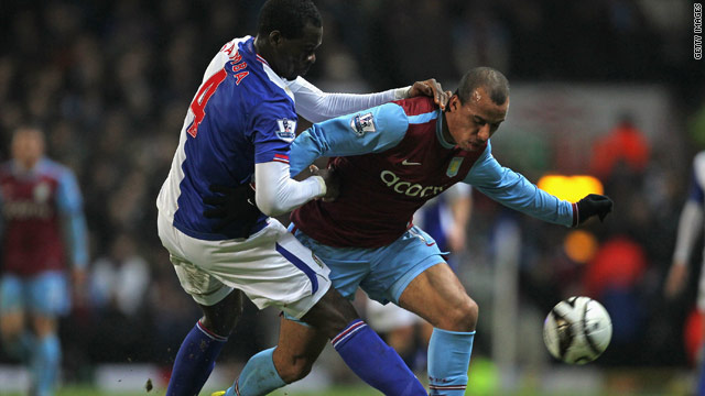 Aston Villa's Gabriel Agbonlahor battles with Blackburn's Christopher Samba during their English League Cup tie.
