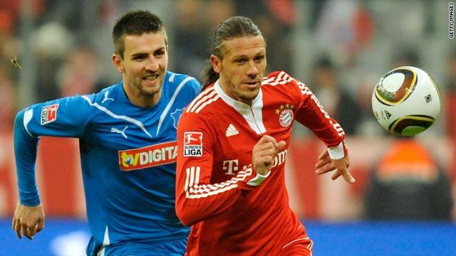 Bayern Munich goalscorer Martin Demichelis, right, vies for the ball with Hoffenheim striker Vedad Ibisevic.