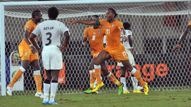 Ivory Coast captain Didier Drogba, center, celebrates after scoring his side's third goal against Ghana.