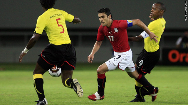 Egypt's Ahmed Hassan, center, vies for the ball with Mucana Martinho and Bucuane Manuel of Mozambique.