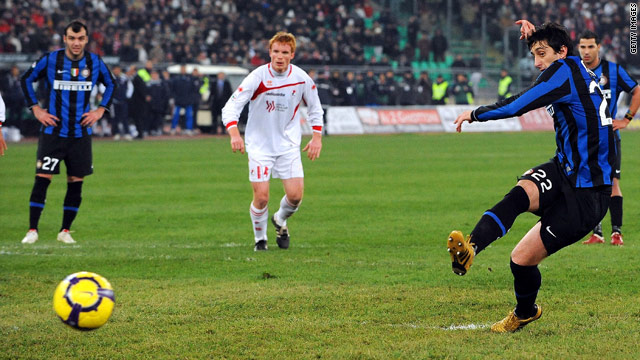 Diego Milito slots home Inter Milan's second goal from the penalty spot to secure a 2-2 draw at Bari.