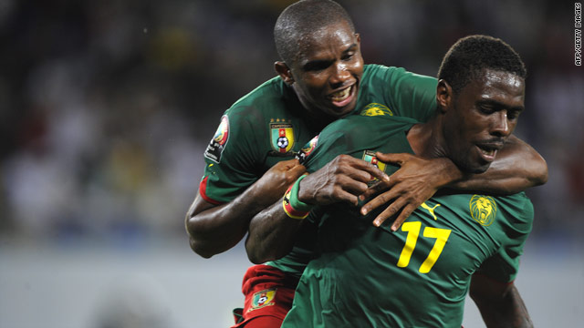 Mohammad Idrissou celebrates Cameroon's winning goal with captain Samuel Eto'o in their 3-2 victory over Zambia.