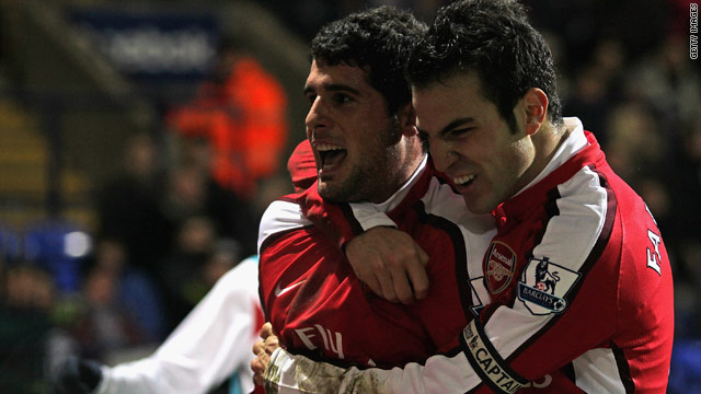 Arsenal goalscorers Cesc Fabregas (right) and Fran Merida celebrate their 2-0 victory at Bolton on Wednesday.