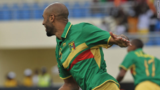 Frederic Kanoute celebrates scoring Mali's opening against Malawi, but their 3-1 win was not enough to see them reach the last eight of the African Nations Cup.
