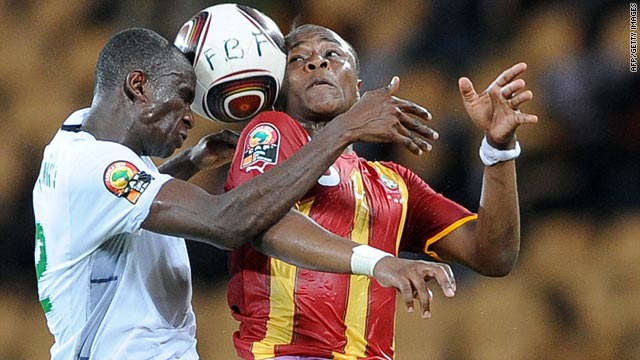 Burkina Faso's Mohamed Koffi, left, leaps for the ball with Ghana's Dede Ayew during Tuesday's match.