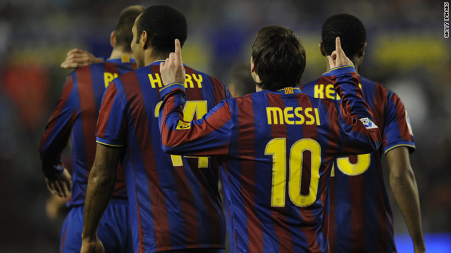 Lionel Messi points to the heavens after helping Barcelona to a 3-0 victory over Real Valladolid on Saturday.