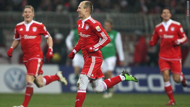 Arjen Robben wheels away in celebration after scoring the decisive goal in Bayern Munich's 3-2 win at Werder Bremen.