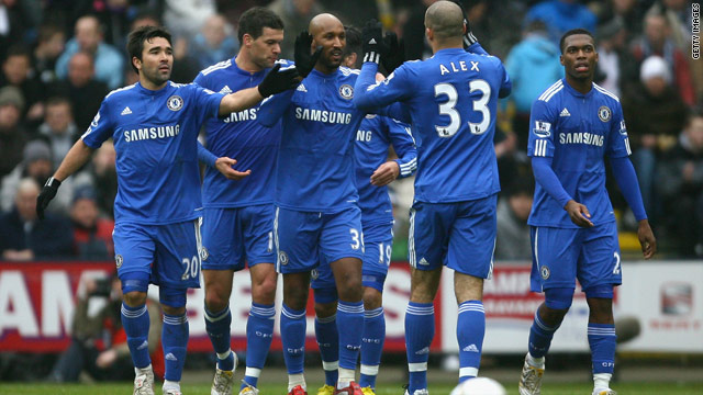 Nicolas Anelka is congratulated by his teammates after opening the scoring in Chelsea's English FA Cup win over Preston.