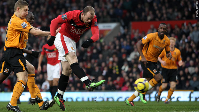 Manchester United striker Wayne Rooney helped his side to 4-0 win over Hull City which sent them top of the Premier League.