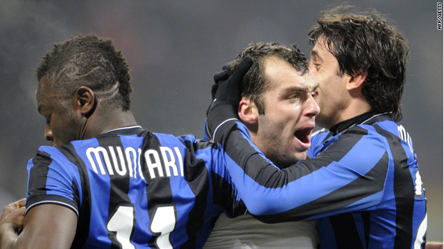 Goran Pandev is congratulated by teammates after his free-kick winner for Inter.