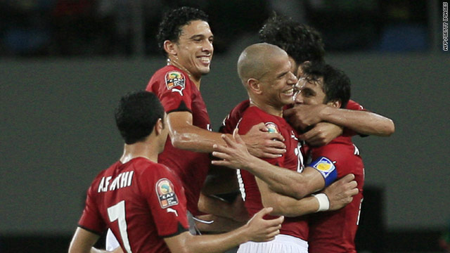 Egypt players celebrate their decisive second goal in the 3-1 quarterfinal victory over Cameroon.