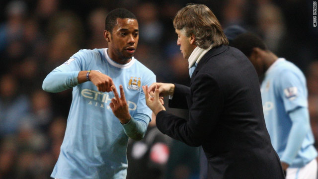 Roberto Mancini has confirmed Manchester City are in negotiations to allow Robinho to leave the club on loan.