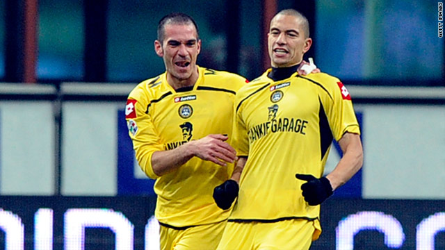 Gokhan Inler (right) celebrates his goal as Udinese stunned Milan to reach the Italian Cup semifinals.