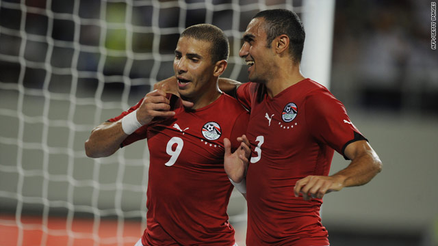 Mohamed Zidan (left) celebrates scoring Egypt's second goal in their comprehensive 4-0 victory over bitter rivals Algeria.