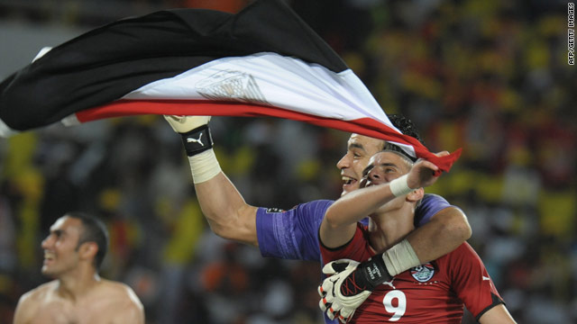 Egypt players celebrate winning the Africa Cup of Nations title for a third successive time with a 1-0 victory over Ghana.