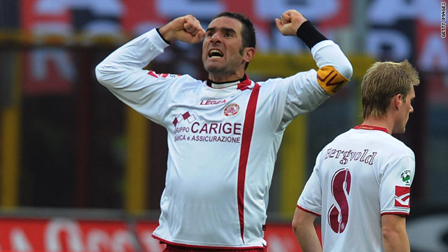 Cristiano Lucarelli celebrates his equalizing goal as Livorno put a massive dent in Milan's Serie A title challenge.