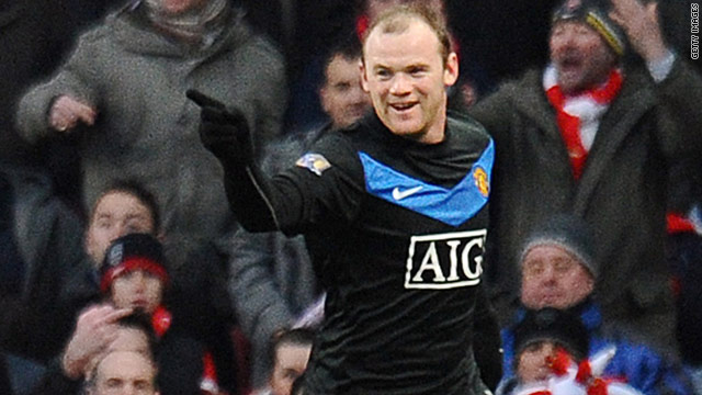 Wayne Rooney celebrates scoring his 100th Premier League goal in Manchester United's superb 3-1 win at Arsenal.