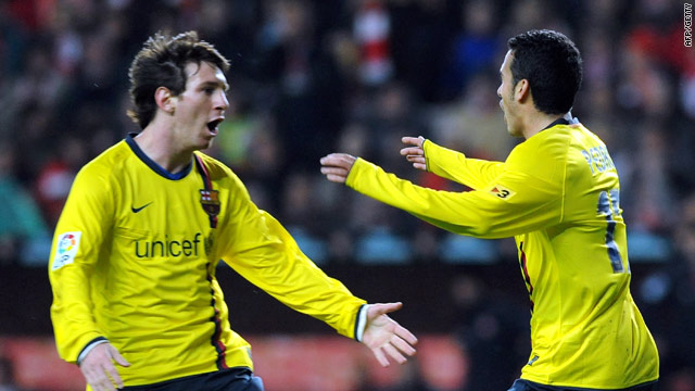 Lionel Messi (left) congratulates goalscorer Pedro as Barcelona stayed five points clear in Spain.