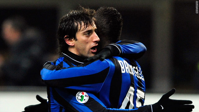 Milito is congratulated after scoring the crucial goal for Inter in the San Siro.