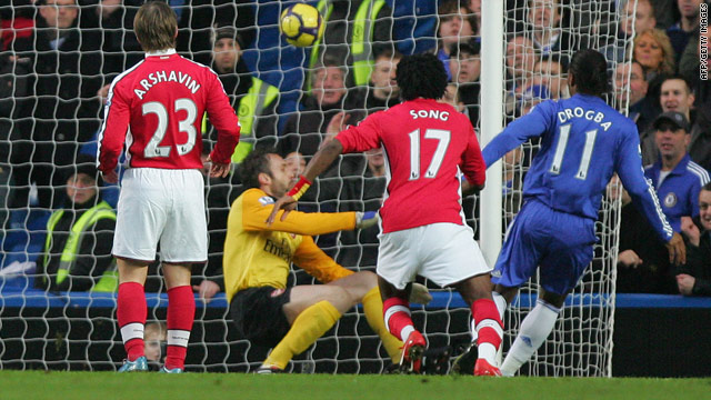 Didier Drogba, far right, puts Chelsea on the way to a 2-0 victory at home to London rivals Arsenal.