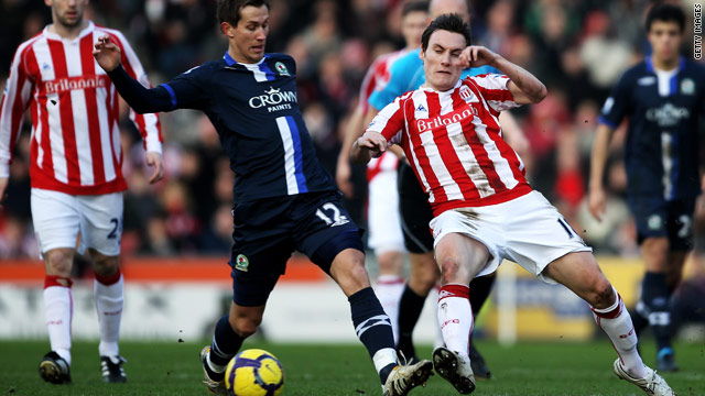 Blackburn's Morten Gamst Perdersen, left, challenges Dean Whitehead of Stoke City during Saturday's match.