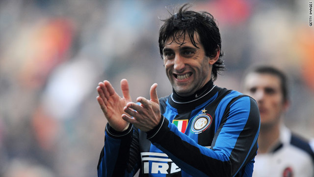 Diego Milito applauds his teammates after being set up to score Inter's third in the San Siro.