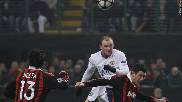 Wayne Rooney, in white, climbs highest to head Manchester United's second goal against AC Milan at the San Siro.